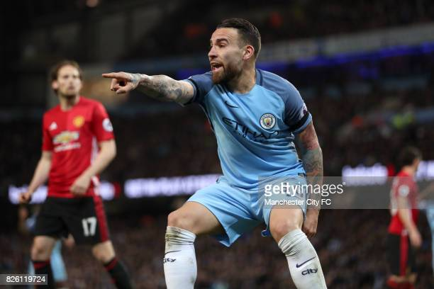 Manchester City's Nicolas Otamendi pints to claim a corner kick