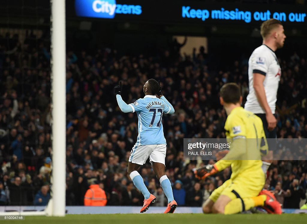 Manchester City's Nigerian striker Kelechi Iheanacho (C) celebrates scoring his team's first goal during the English Premier League football match between Manchester City and Tottenham Hotspur at the Etihad Stadium in Manchester, north west England, on February 14, 2016. / AFP / PAUL ELLIS / RESTRICTED TO EDITORIAL USE. No use with unauthorized audio, video, data, fixture lists, club/league logos or 'live' services. Online in-match use limited to 75 images, no video emulation. No use in betting, games or single club/league/player publications. /