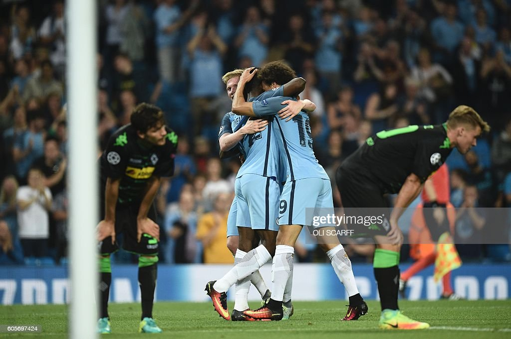 Manchester City's Nigerian striker Kelechi Iheanacho (C) celebrates scoring their fourth goal during the UEFA Champions League group C football match between Manchester City and Borussia Monchengladbach at the Etihad stadium in Manchester, northwest England, on September 14, 2016. / AFP / OLI