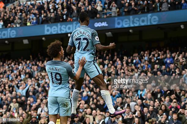 Manchester City's Nigerian striker Kelechi Iheanacho celebrates with Manchester City's German midfielder Leroy Sane after scoring their first goal...