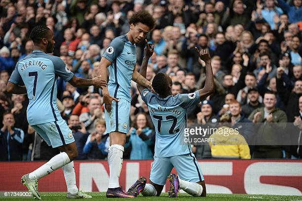 Manchester City's Nigerian striker Kelechi Iheanacho celebrates with Manchester City's German midfielder Leroy Sane and Manchester City's English...