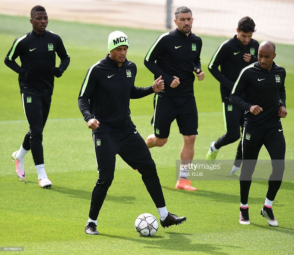 Manchester City's Nigerian striker Kelechi Iheanacho (L), Manchester City's Belgian defender Vincent Kompany (2L), Manchester City's Serbian defender Aleksandar Kolarov (C), Manchester City's Spanish midfielder Jesus Navas (2R), and Manchester City's English midfielder Fabian Delph attend a team training session at the City Academy in Manchester, north west England, on May 3, 2016. Manchester City will play against Real Madrid CF in a UEFA Champions League semi-final second leg football match in Madrid on May 4. / AFP / PAUL