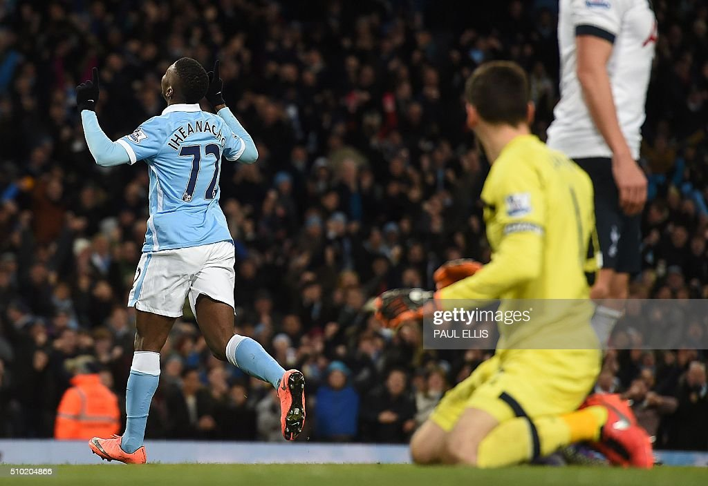 Manchester City's Nigerian striker Kelechi Iheanacho (L) runs past Tottenham Hotspur's French goalkeeper Hugo Lloris as he celebrates scoring his team's first goal during the English Premier League football match between Manchester City and Tottenham Hotspur at the Etihad Stadium in Manchester, north west England, on February 14, 2016. / AFP / PAUL ELLIS / RESTRICTED TO EDITORIAL USE. No use with unauthorized audio, video, data, fixture lists, club/league logos or 'live' services. Online in-match use limited to 75 images, no video emulation. No use in betting, games or single club/league/player publications. /
