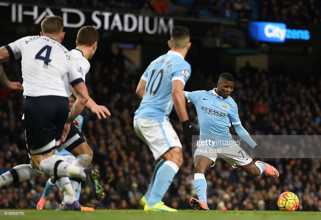 Manchester City's Nigerian striker Kelechi Iheanacho (R) scores his team's first goal during the English Premier League football match between Manchester City and Tottenham Hotspur at the Etihad Stadium in Manchester, north west England, on February 14, 2016. / AFP / PAUL ELLIS / RESTRICTED TO EDITORIAL USE. No use with unauthorized audio, video, data, fixture lists, club/league logos or 'live' services. Online in-match use limited to 75 images, no video emulation. No use in betting, games or single club/league/player publications. /