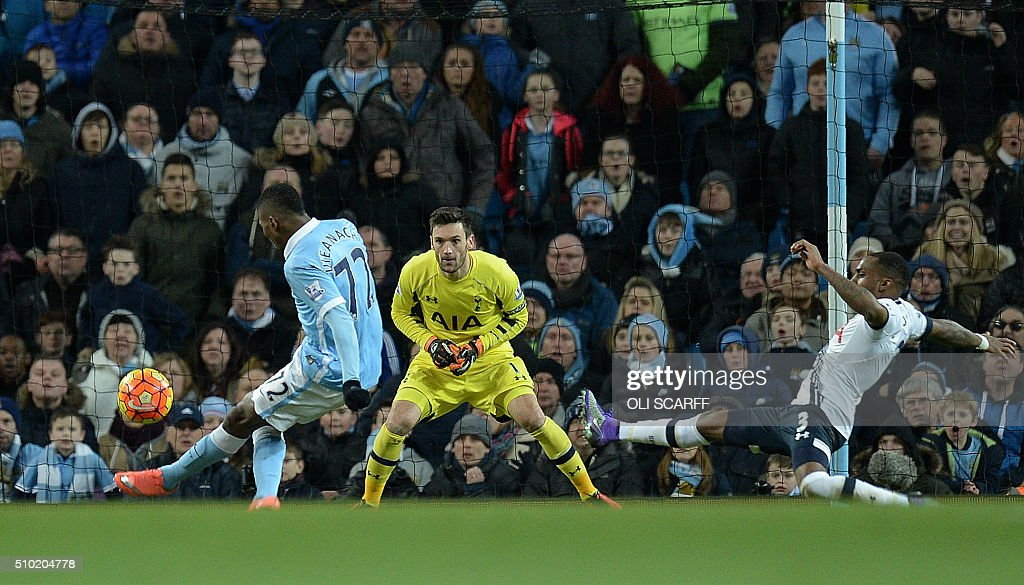 Manchester City's Nigerian striker Kelechi Iheanacho (L) shoots past Tottenham Hotspur's French goalkeeper Hugo Lloris to score his team's first goal during the English Premier League football match between Manchester City and Tottenham Hotspur at the Etihad Stadium in Manchester, north west England, on February 14, 2016. / AFP / OLI SCARFF / RESTRICTED TO EDITORIAL USE. No use with unauthorized audio, video, data, fixture lists, club/league logos or 'live' services. Online in-match use limited to 75 images, no video emulation. No use in betting, games or single club/league/player publications. /
