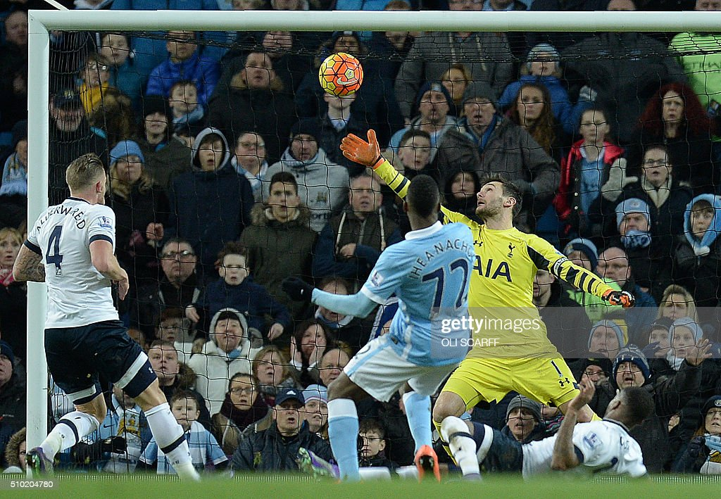 Manchester City's Nigerian striker Kelechi Iheanacho (C) shoots past Tottenham Hotspur's French goalkeeper Hugo Lloris to score his team's first goal during the English Premier League football match between Manchester City and Tottenham Hotspur at the Etihad Stadium in Manchester, north west England, on February 14, 2016. / AFP / OLI SCARFF / RESTRICTED TO EDITORIAL USE. No use with unauthorized audio, video, data, fixture lists, club/league logos or 'live' services. Online in-match use limited to 75 images, no video emulation. No use in betting, games or single club/league/player publications. /