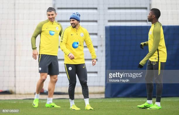 Manchester City's Nolito Aleksandar Kolarov and Kelechi Iheanacho during training
