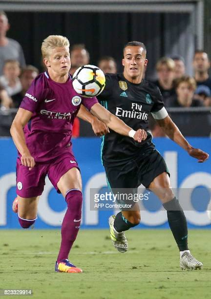 Manchester City's Oleksandr Zinchenko and Real Madrid's Lucas Vazquez fight for the ball during the International Champions Cup football match in Los...