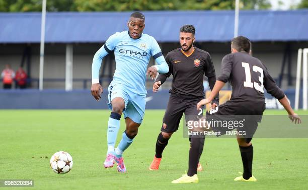 Manchester City's Olivier Ntcham battles for the ball against AS Roma's Daniele Verde and Andrea Paolelli