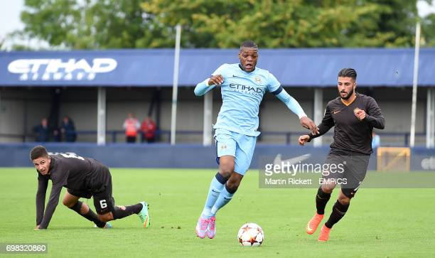 Manchester City's Olivier Ntcham battles for the ball with against AS Roma's Lorenzo Vasco and Daniele Verde