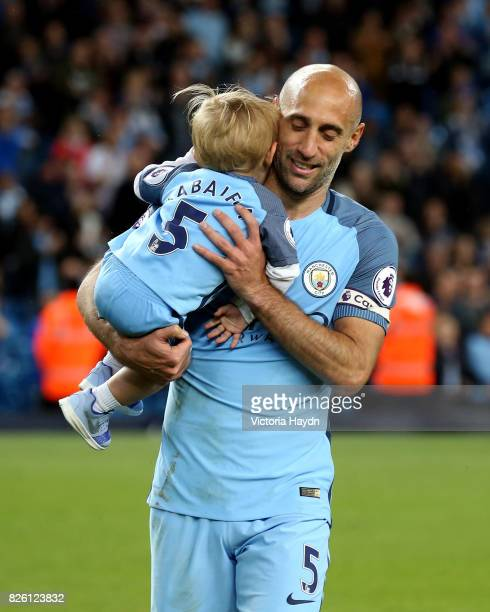 Manchester City's Pablo Zabaleta acknowledges the fans with son Asier after the game