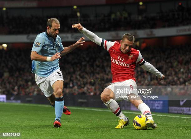 Manchester City's Pablo Zabaleta and Arsenal's Lukas Podolski in action