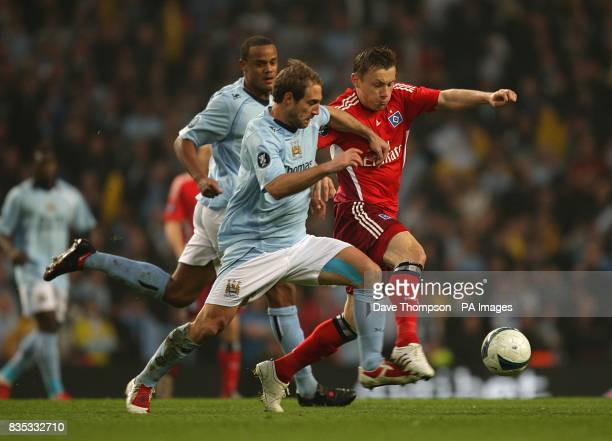 Manchester City's Pablo Zabaleta and Hamburg's Ivica Olic battle for the ball