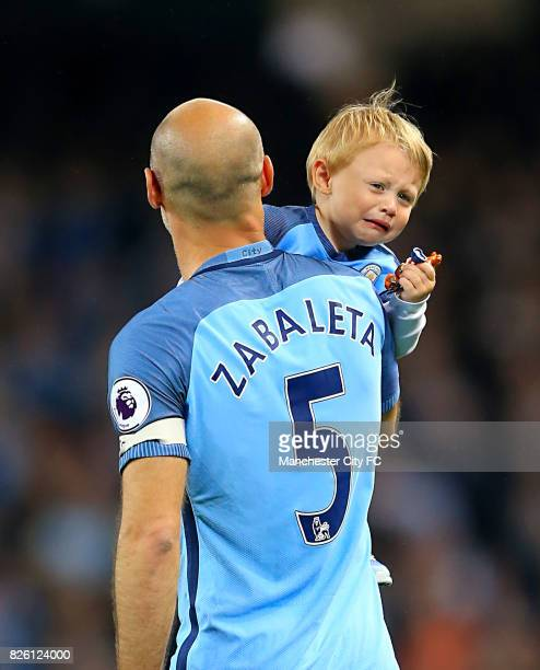 Manchester City's Pablo Zabaleta and his son Asier Zabaleta after the final whistle