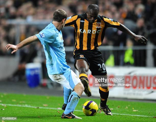 Manchester City's Pablo Zabaleta and Hull City's George Boateng battle for the ball