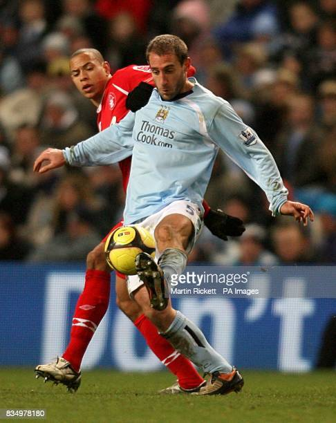 Manchester City's Pablo Zabaleta and Nottingham Forest's Nathan Tyson battle for the ball