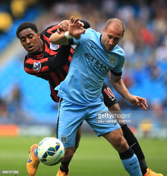 Manchester City's Pablo Zabaleta and Queens Park Rangers' Leroy Fer