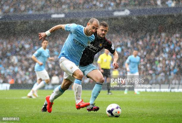 Manchester City's Pablo Zabaleta and West Ham United's George McCartney battle for the ball
