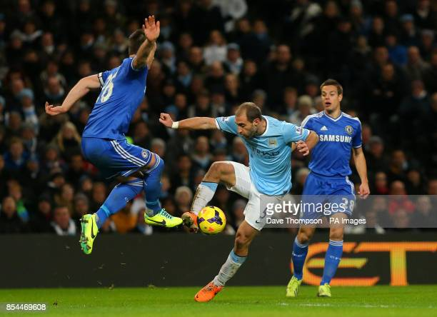 Manchester City's Pablo Zabaleta battles for the ball with Chelsea's John Terry during the Barclays Premier League match against Chelsea at The...