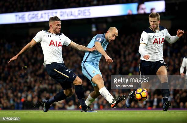 Manchester City's Pablo Zabaleta battles for the ball with Tottenham Hotspur's Toby Alderweireld and Eric Dier