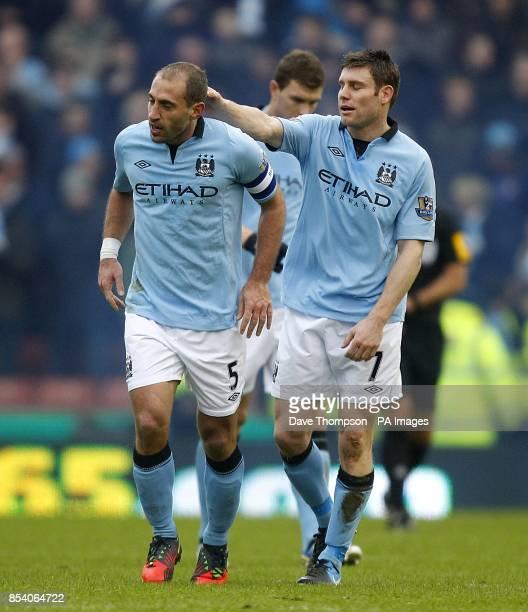 Manchester City's Pablo Zabaleta celebrates scoring his side's first goal with teammate James Milner