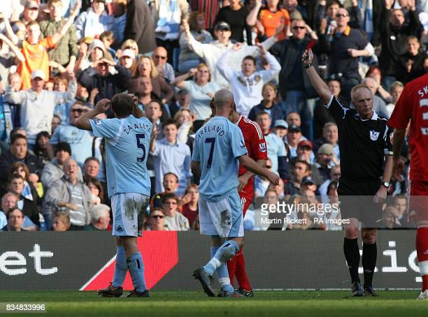 Manchester City's Pablo Zabaleta dejected as he is sent off by referee Peter Walton