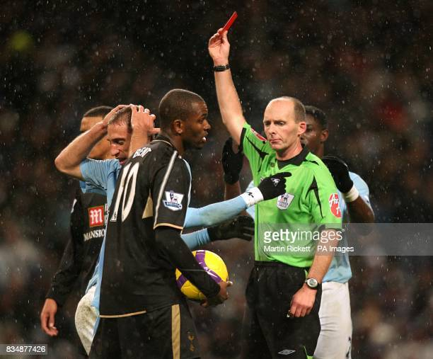 Manchester City's Pablo Zabaleta holds his head in his hands after teammate Richard Dunne is shown the red card by referee Mike Dean