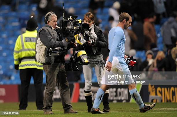 Manchester City's Pablo Zabaleta is follwed by a cameraman as he leaves the field after the final whistle