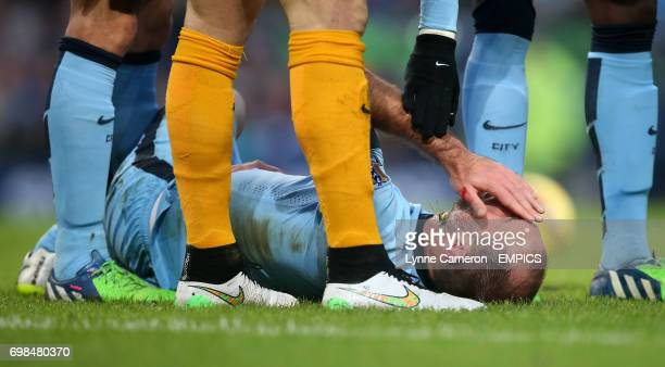 Manchester City's Pablo Zabaleta lies on the pitch with a face injury