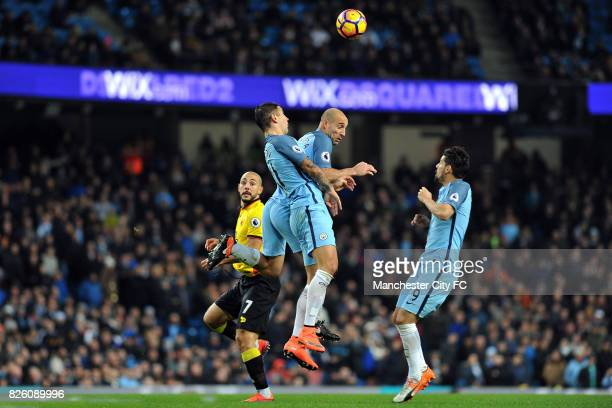 Manchester City's Pablo Zabaleta Nolito and Aleksandar Kolarov and Watford's Nordin Amrabat in action during the Premiership match at the Etihad...