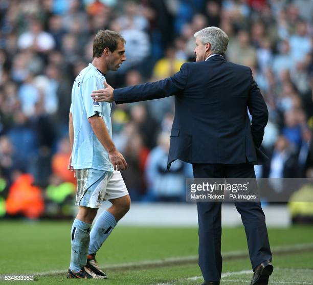 Manchester City's Pablo Zabaleta walks towards his manager Mark Hughes after he is sent off by referee Peter Walton