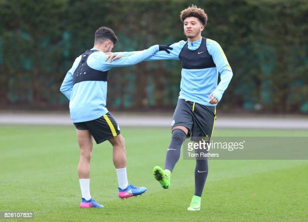 Manchester City's Paolo Fernandes and Jadon Sancho in training