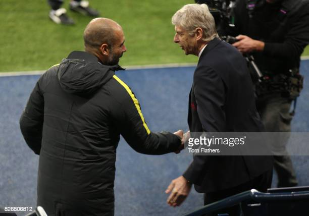 Manchester City's Pep Guardiola shakes hands with Arsenal's Arsene Wenger