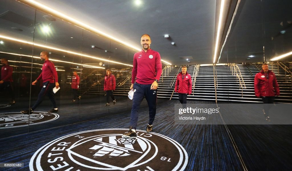 Manchester City's Pep Guardiola visits the new glass tunnel at Etihad Stadium on August 19, 2017 in Manchester, England.