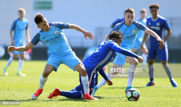 Manchester City's Phil Foden and Benjamin Garre in action against Chelsea