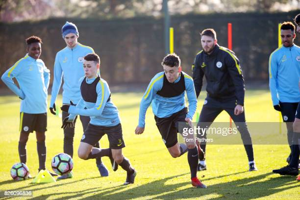 Manchester City's Phil Foden and Colin Rosler during training at City Football Academy