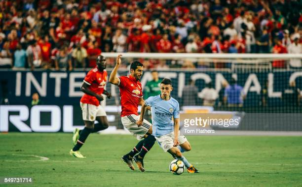 Manchester City's Phil Foden and Manchester United's Henrikh Mkhitaryan in action at NRG Stadium on July 20 2017 in Houston Texas