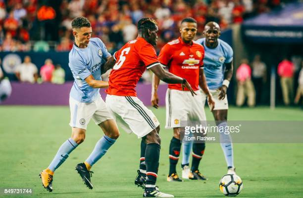 Manchester City's Phil Foden and Manchester United's Paul Pogba in action at NRG Stadium on July 20 2017 in Houston Texas