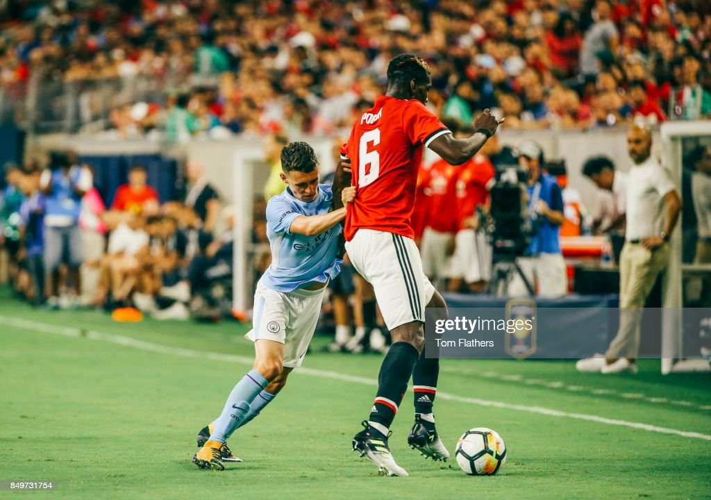http://media.gettyimages.com/photos/manchester-citys-phil-foden-and-manchester-uniteds-paul-pogba-in-at-picture-id849731754