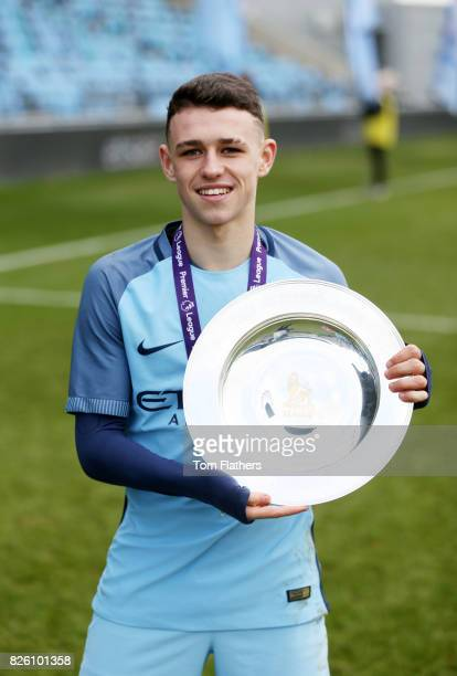 Manchester City's Phil Foden celebrates winning the U18 Northern Premier League trophy