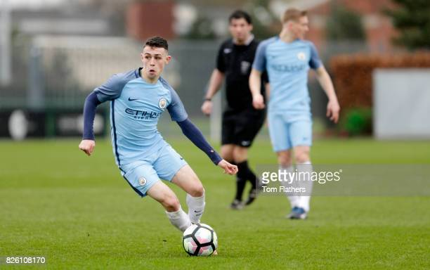 Manchester City's Phil Foden in action against Manchester United