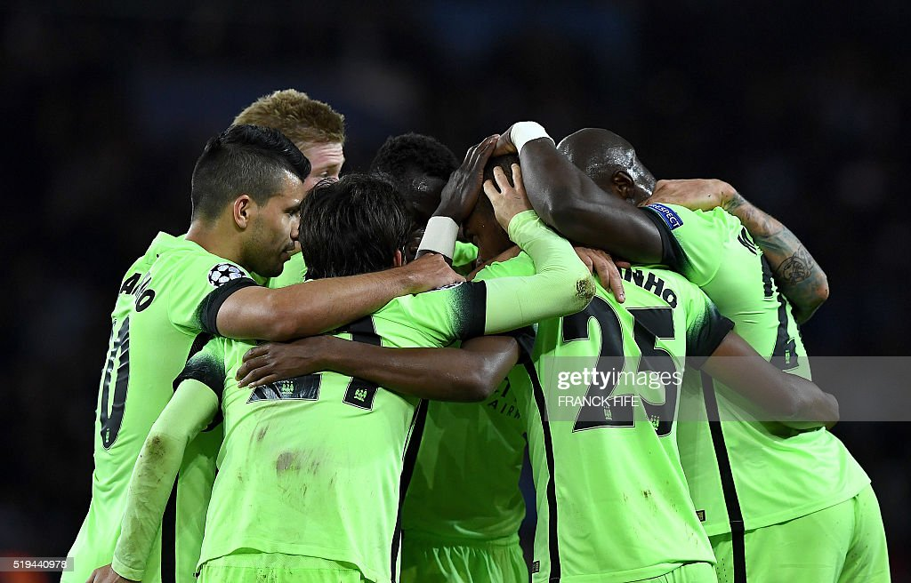 TOPSHOT - Manchester City's players celebrate after scoring a goal during the UEFA Champions League quarter final football match between Paris Saint Germain (PSG) and Manchester City on April 6, 2016 at the Parc des Princes stadium in Paris.