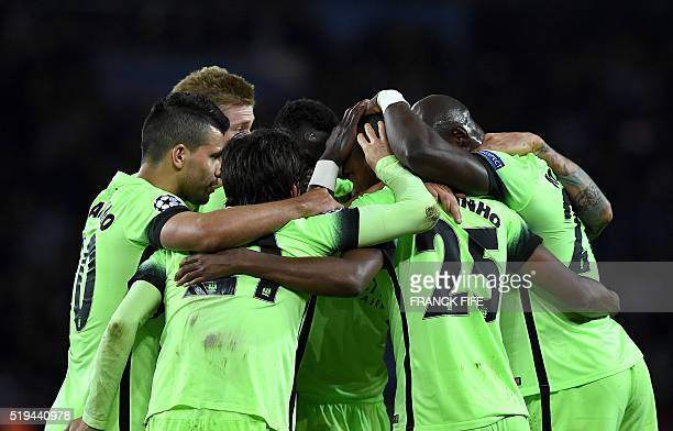 TOPSHOT Manchester City's players celebrate after scoring a goal during the UEFA Champions League quarter final football match between Paris Saint...
