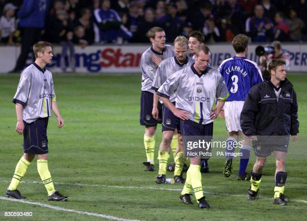LEAGUE Manchester City's players left to right Danny Granville Richard Dunne Gerard Wiekens Spencer Prior Paul Dickov after being relagated to...