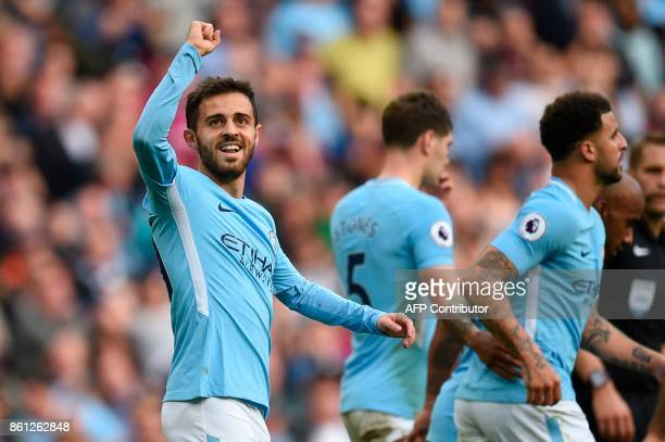 Manchester City's Portuguese midfielder Bernardo Silva celerbates scoring their seventh goal during the English Premier League football match between...