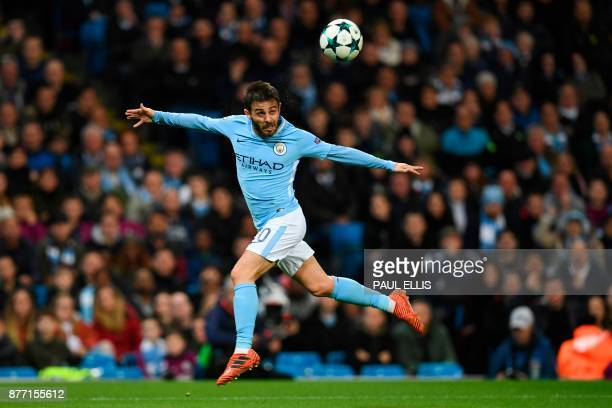 TOPSHOT Manchester City's Portuguese midfielder Bernardo Silva heads the ball during the UEFA Champions League Group F football match between...