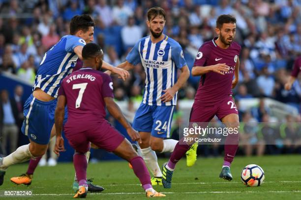 Manchester City's Portuguese midfielder Bernardo Silva runs with the ball during the English Premier League football match between Brighton and Hove...
