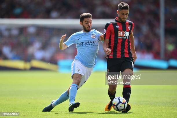 Manchester City's Portuguese midfielder Bernardo Silva vies with Bournemouth's South Africanborn English midfielder Andrew Surman during the English...
