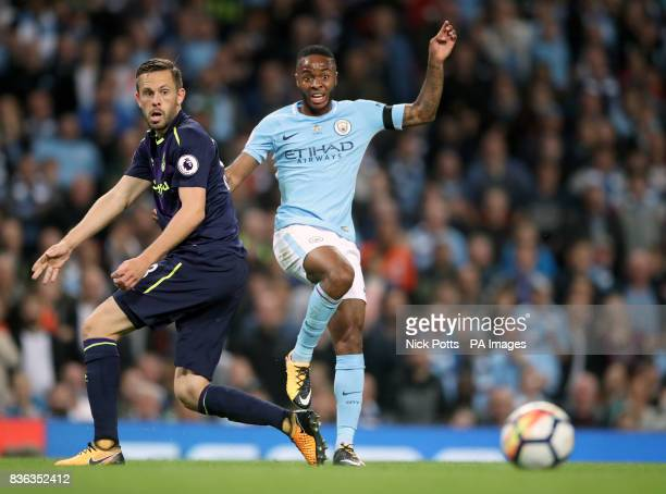 Manchester City's Raheem Sterling and Everton's Gylfi Sigurdsson battle for the ball during the Premier League match at the Etihad Stadium Manchester