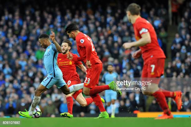 Manchester City's Raheem Sterling and Liverpool's Adam Lallana in action during the Barclay's Premiership match at the Etihad Stadium Manchester on...